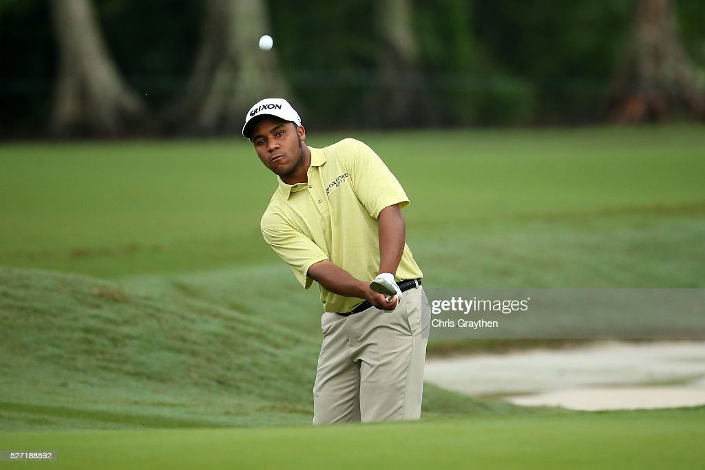 Harold Varner III hits his third shot on the 8th hole during a continuation of the third round of the Zurich Classic at TPC Louisiana on May 2, 2016 in Avondale, Louisiana.