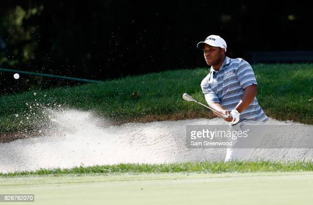 Harold Varner III hits out of a bunker on the 16th hole during the third round of the World Golf Championships Bridgestone Invitational at Firestone...