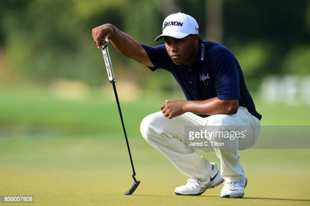 Harold Varner III lines up a putt on the 15th green during the second round of the Wyndham Championship at Sedgefield Country Club on August 18 2017...