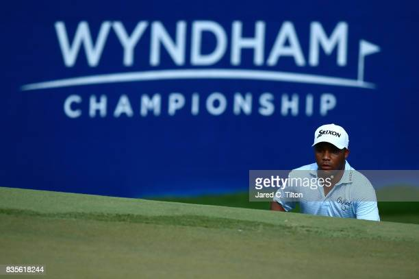 Harold Varner III lines up a putt on the 17th green during the third round of the Wyndham Championship at Sedgefield Country Club on August 19 2017...