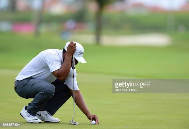 Harold Varner III lines up his birdie putt on the 18th green during the first round of the Puerto Rico Open at Coco Beach on March 23 2017 in Rio...