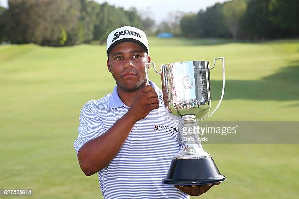 Harold Varner III of the USA celebrates after winning the Joe Kirkwood trophy on day four of the 2016 Australian PGA Championship at RACV Royal Pines...