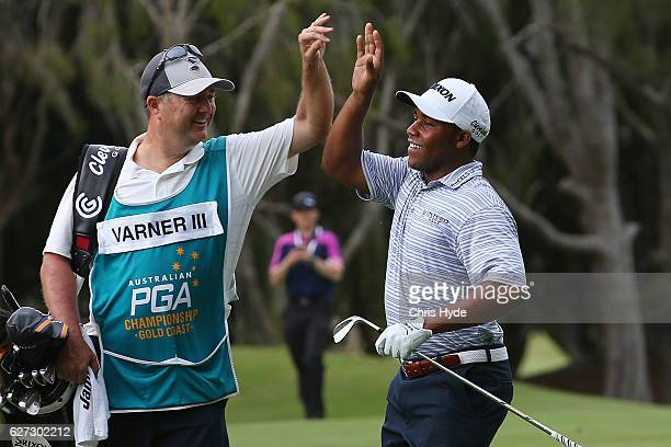 Harold Varner III of the USA celebrates with his caddy after getting an eagle on the 17th hole during day three of the Australian PGA Championships...