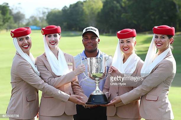 Harold Varner III of the USA poses with Emirates cabin crew after winning the Joe Kirkwood trophy on day four of the 2016 Australian PGA Championship...