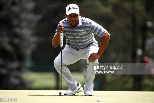 Harold Varner III prepares to putt on the first green during the third round of the World Golf Championships Bridgestone Invitational at Firestone...