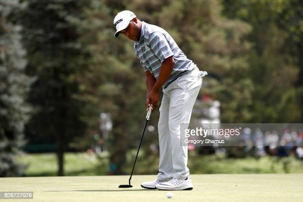 Harold Varner III putts on the first green during the third round of the World Golf Championships Bridgestone Invitational at Firestone Country Club...