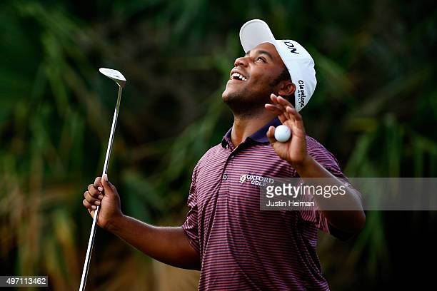 Harold Varner III reacts after putting on the first hole green during the third round of the OHL Classic at the Mayakoba El Camaleon Golf Club on...