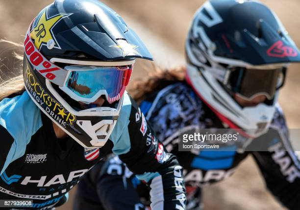 Haro's Payton Ridenhour and Addison Finch race through the third straight during 1516 Girls class action at the USA BMX Mile High Nationals on August...
