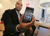 Harp Dhonsi shows off his new BlackBerry Z10 at Rogers store at 333 BloorSt East in Toronto February 5 2013 Canadians who have clung to their aging...