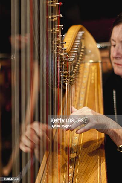 Harp player in orchestra