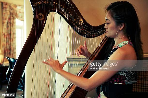 Harp player in the Carcosa Serinegara historic hotel in Kuala Lumpur Malaysia