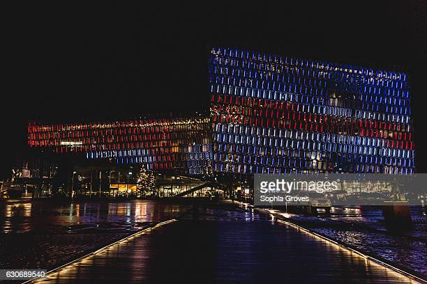 Harpa Concert Hall lit up in the colours of the Icelandic flag The facade was designed by the famous DanishIcelandic artist Olafur Eliasson December...
