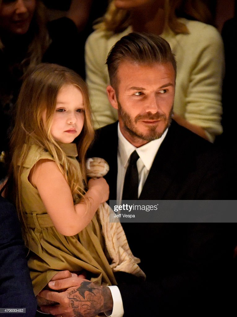Harper Beckham (L) and David Beckham attend the Burberry 'London in Los Angeles' event at Griffith Observatory on April 16, 2015 in Los Angeles, California.
