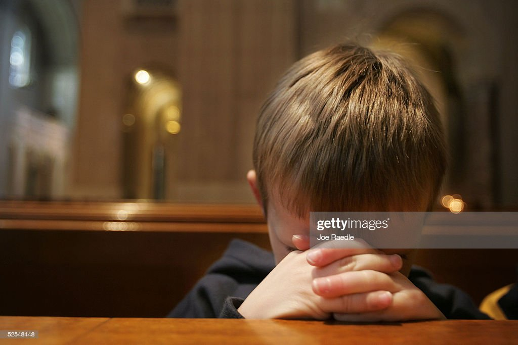 Harper Dorsey prays for Pope John Paul II in the Basilica of the National Shrine of the Immaculate Conception April 1 2005 in Washington DC The...