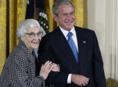 Harper Lee left the author of 'To Kill a Mockingbird' receives the Presidential Medal of Freedom from US President George W Bush right during a...