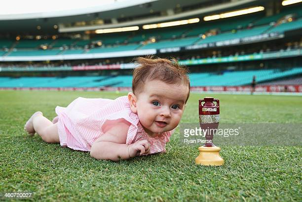 Harper Lyon daughter of Nathan Lyon of Australia poses with the urn after day three of the Fifth Ashes Test match between Australia and England at...