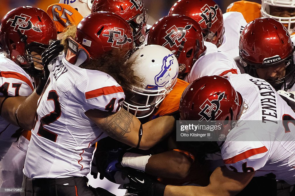 D.J. Harper #7 of the Boise State Broncos is brought down by the San Diego State Aztecs at Bronco Stadium on November 3, 2012 in Boise, Idaho.