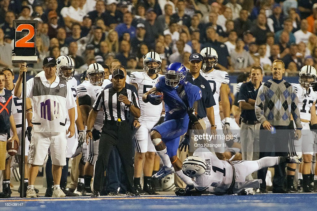 D.J. Harper #7 of the Boise State Broncos is grabbed by Joe Sampson #1 of the BYU Cougars at Bronco Stadium on September 20, 2012 in Boise, Idaho.