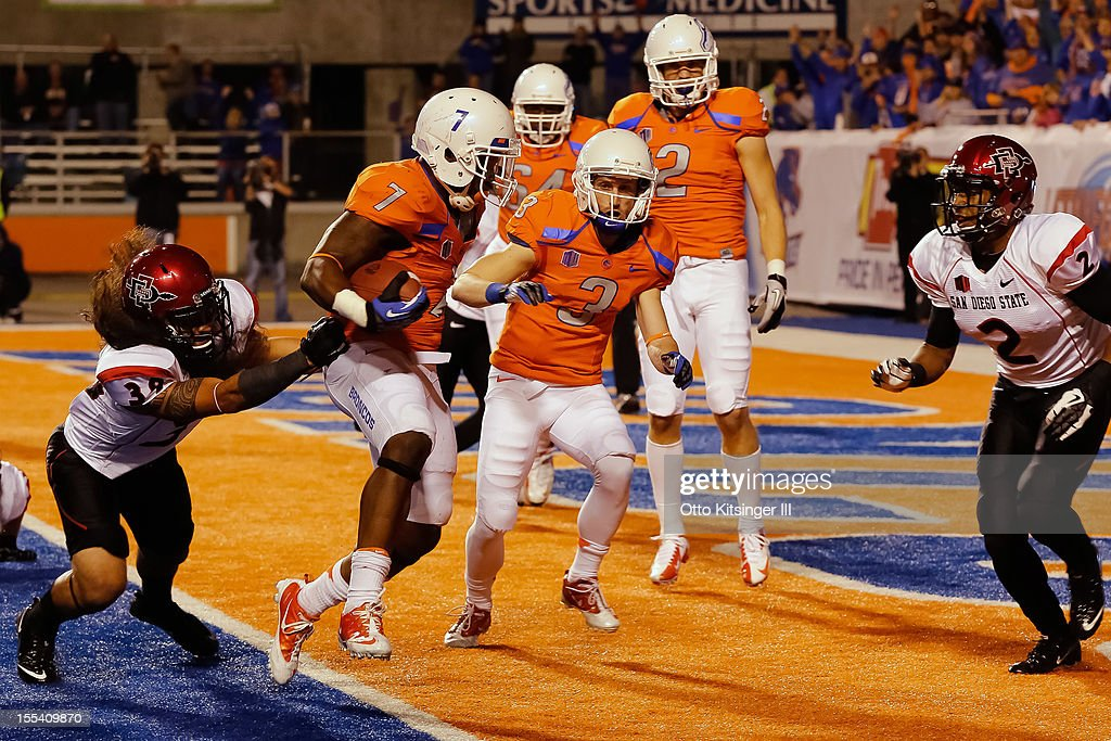 D.J. Harper #7 of the Boise State Broncos runs in for a touchdown against the San Diego State Aztecs at Bronco Stadium on November 3, 2012 in Boise, Idaho.