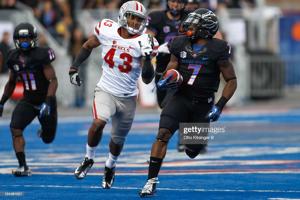 D.J. Harper #7 of the Boise State Broncos runs the ball against Tim Hasson #43 of the UNLV Rebels at Bronco Stadium on October 20, 2012 in Boise, Idaho.