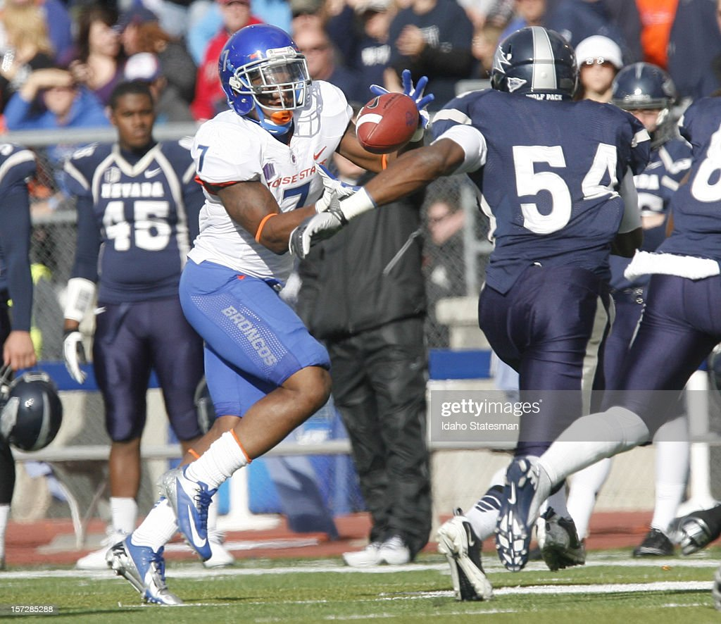 D.J. Harper of the Boise State Broncos takes a pitch from quarterback Joe Southwick against the University of Nevada during a college football game at Mackay Stadium on Saturday, December 1, 2012, in Reno, Nevada. The Boise State Broncos defeated the Nevada Wolf Pack, 27-21.