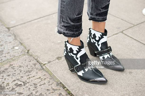 Harper's Bazaar junior fashion editor Anna Rosa Vitiello wears Sandro jeans and Zadig and Voltaire shoes on day 2 during London Fashion Week...