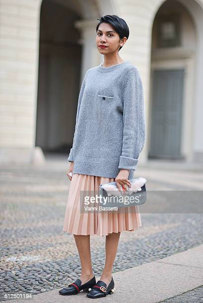 Harper's Bazaar Malasya Sharmita Summugam poses wearing an Acne Studios jumper Fendi bag and Gucci loafers before the Tod's show during the Milan...