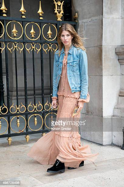 Harper's Bazaar Style Editor Veronika Heilbrunner wears Aquazzura boots Chloe dress and a Levis jacket on day 7 during Paris Fashion Week...