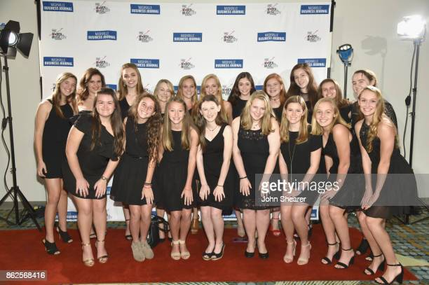 Harpeth Hall School Chamber Choir arrives at the 2017 Nashville Business Journal Women In Music City on October 17 2017 in Nashville Tennessee
