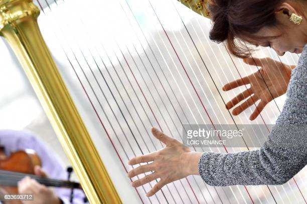 Harpist Kyunghee KimSutre performs in front of patients in a rehabilitation center of the Nantes University Hospital during the 23rd edition of the...