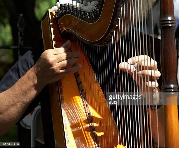 Harpist playing in sunshine