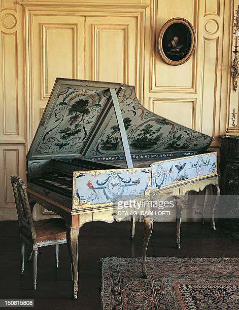 Harpsichord decorated with animal and vegetables motifs on a white background painted by Jean Baptiste Huet and preserved within the White salon...