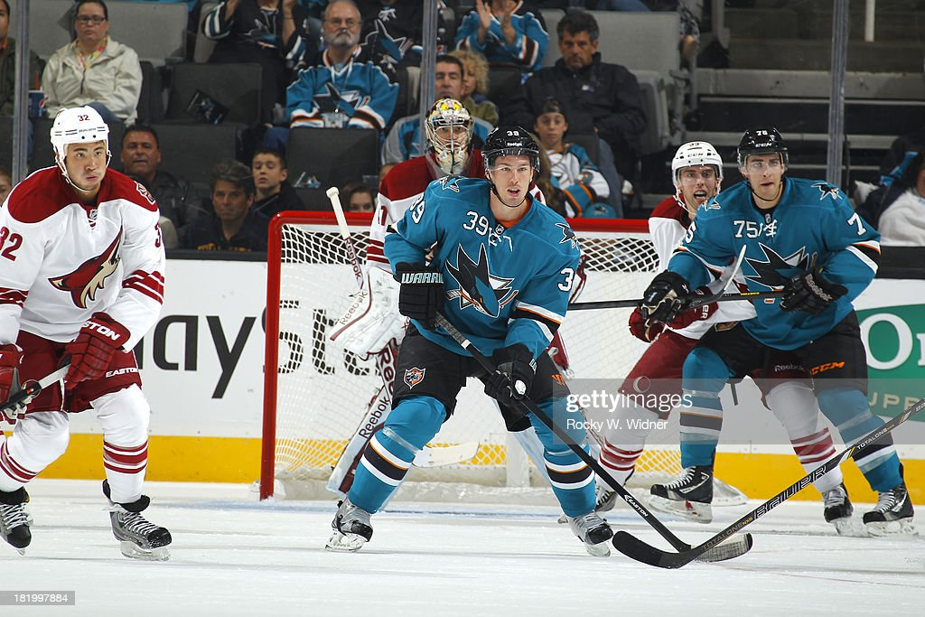 Harri Sateri and Freddie Hamilton of the San Jose Sharks skate into position against Brandon Yip and Brandon Gormley of the Phoenix Coyotes during a...
