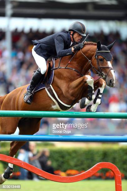 Harrie SMOLDERS riding EMERALD NOP during the Rolex Grand Prix part of the Rolex Grand Slam of Show Jumping of the World Equestrian Festival on July...