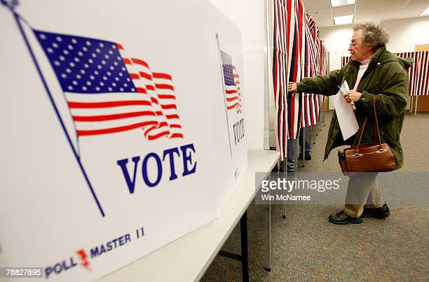 Harriet Boylan heads into a voting booth to cast her vote in the New Hampshire presidential primary at the Ward 3 Carol M Rines Center January 8 2008...