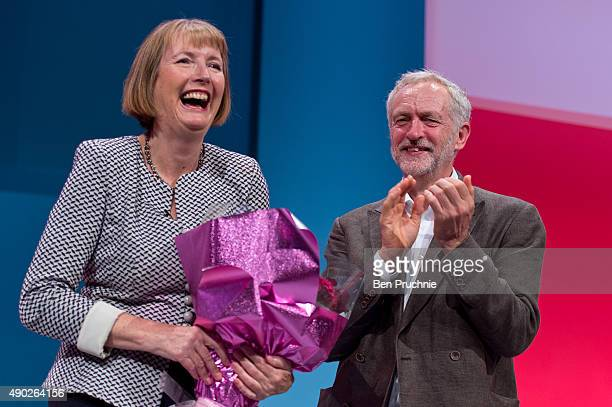 Harriet Harman is presented a bouquet of flowers by Labour Leader Jeremy Corbyn during her tribute on the first day of the Labour Party Autumn...