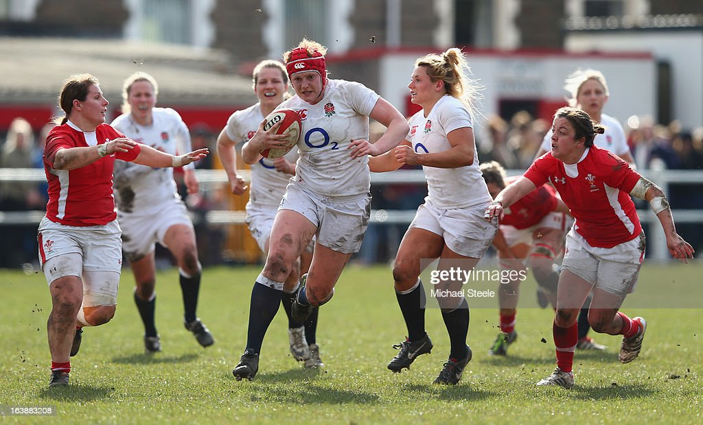 Harriet Millar-Mills (C) of England bursts through the Wales defence during the Wales v England Women's Six Nations match at the Talbot Athletic Ground on March 17, 2013 in Port Talbot, Wales.