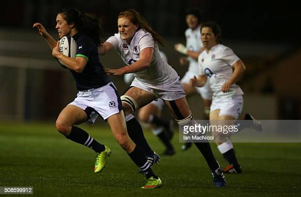 Harriet MillarMills of England chases Rhona Lloyd of Scotland during the Scotland Women and England Women Six Nations Championship match at Broadwood...