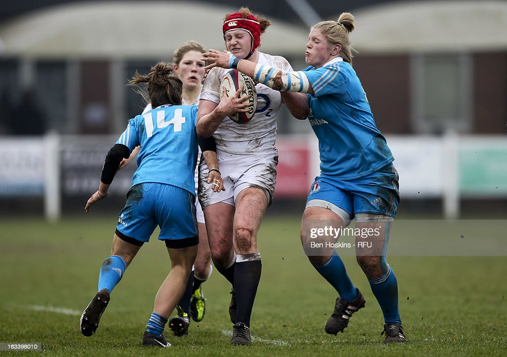 Harriet Millar-Mills of England is tackled by Veronese Maria Diletta (L) and Severin Flavia (R) of Italy during the Women's RBS Six Nations match between England and Italy at Esher Rugby Club on March 09, 2013 in Esher, England.