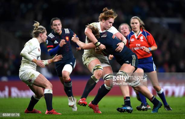 Harriet MillarMills of England tackles Romane Menager of France during the Women's Six Nations match between England and France at Twickenham Stadium...