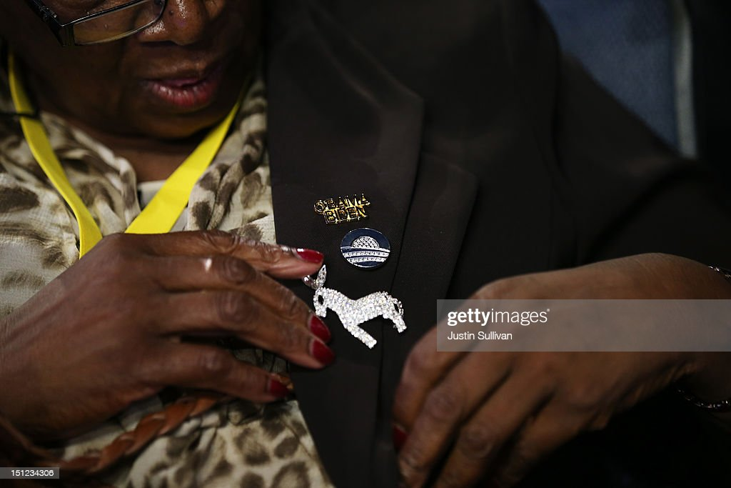 Harriet Smith adjusts her Democratic donkey pin on her jacket during day one of the Democratic National Convention at Time Warner Cable Arena on...