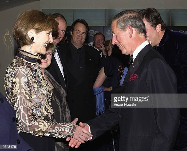 Harriet Walter meets HRH Prince Charles as actors Dan Aykroyd and Stephen Fry look on as they attend the European Film Premier of 'Bright Young...