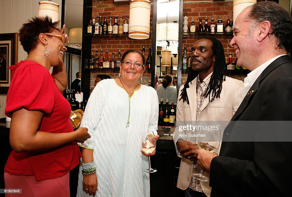 Harriette Cole, Fern Mallis, Kevan Hall and Jeffrey Moss talk at a celebration of Ruby Dee's style at Melba's restaurant on June 9, 2008 in New York City.