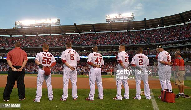 J Harrington Kole Calhoun David Freese Howie Kendrick Mike Trout Erick Aybar and Albert Pujols of the Los Angeles Angels of Anaheim stand for the...