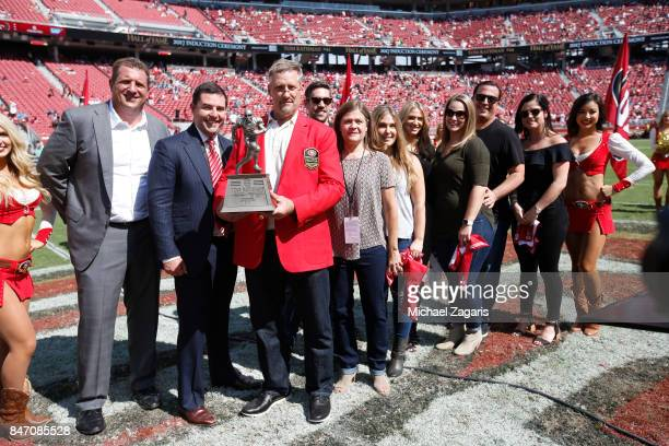 Harris Barton CEO Jed York of the San Francisco 49ers and Tom Rathman stand on the field after Tathman was inducted into the 49ers Hall of Fame...