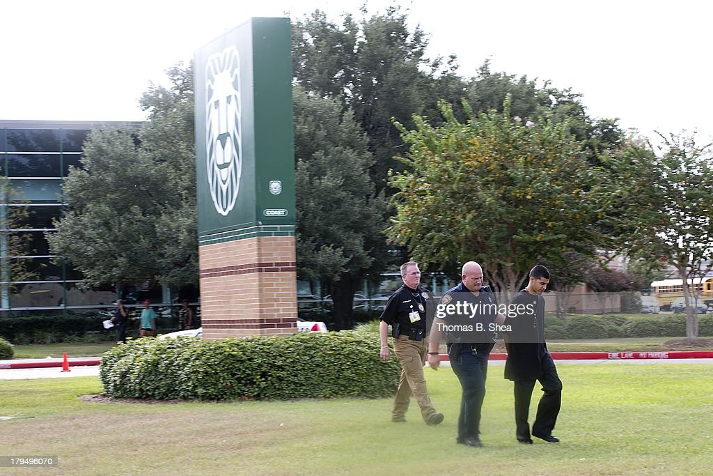 A Harris County Sheriff arrests a person on the grounds of Spring High School September 4, 2013 in Spring, Texas. A 17-year-old student was fatally stabbed and three other students during what has been reported as a fight at the school about 7:00 am. Three people have been taken into custody.