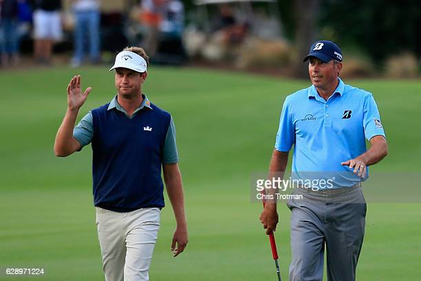 Harris English and his teammate Matt Kuchar walk up the 18th fairway during the final round of the Franklin Templeton Shootout at Tiburon Golf Club...