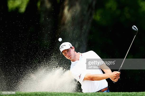Harris English of the United States hits a shot from a greenside bunkerduring a practice round prior to the start of the 96th PGA Championship at...