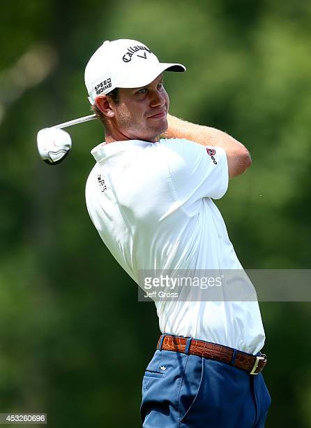 Harris English of the United States hits a tee shot uring a practice round prior to the start of the 96th PGA Championship at Valhalla Golf Club on...