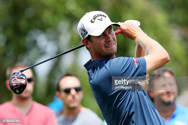 Harris English plays his shot from the third tee during the first round of the Travelers Championship at TPC River Highlands on June 25 2015 in...